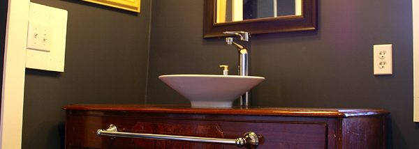How to convert a buffet into a bathroom vanity using a vessel sink.