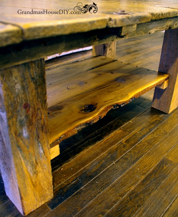 Rustic barn door coffee table made out of 4x4s with a rustic pine shelf added