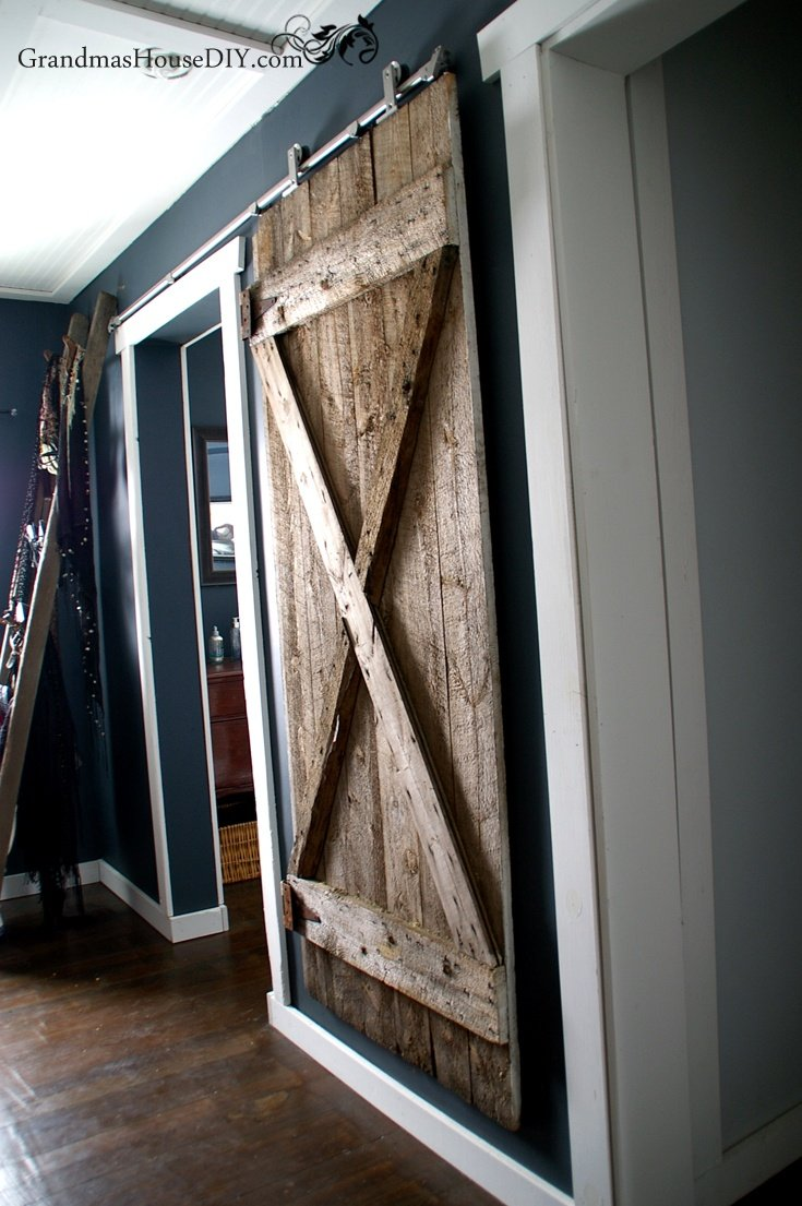 i finally got my hanging barn door up how to install with hardware. Black Bedroom Furniture Sets. Home Design Ideas