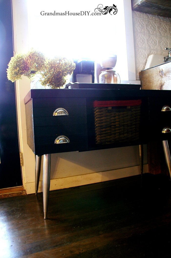 Old retro desk gets black paint and chrome spray paint in a diy makeover to become our coffee station, before and after