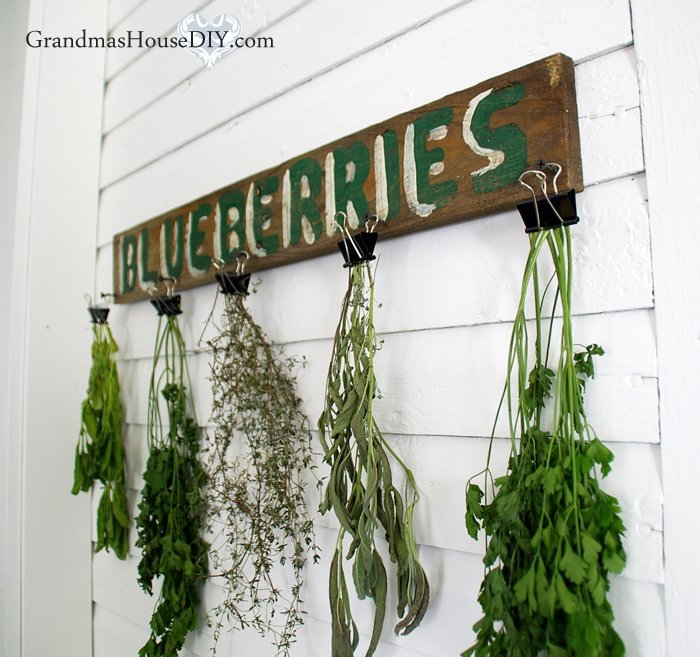 A DIY build project of a simple sign combined with office binder clips to create a great herb drying rack or hat rack or anything really!