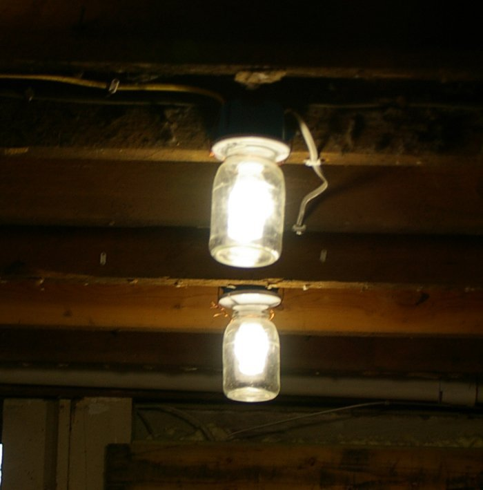 Jar light bulb covers DIY with leftover wire, a keyless lamp holder and a big mason jar for easy, cheap, inexpensive, basement lighting.