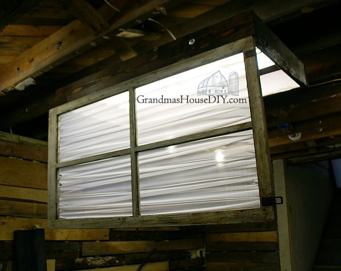 How to DIY a florescent light box cover out of an old window, a sheer curtain and 2x6s stained and painted, wood working tips and tutorials.