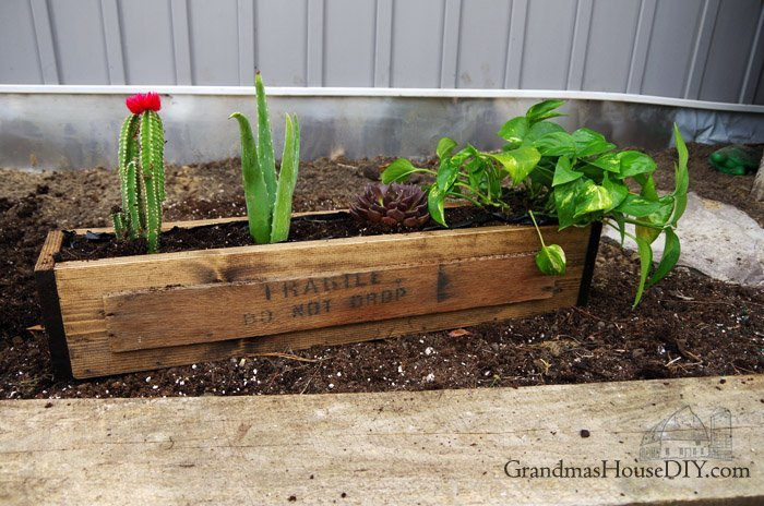 A veggie garden with railroad ties, some mystery seeds, new flower boxes and a new remodel project called the little house!