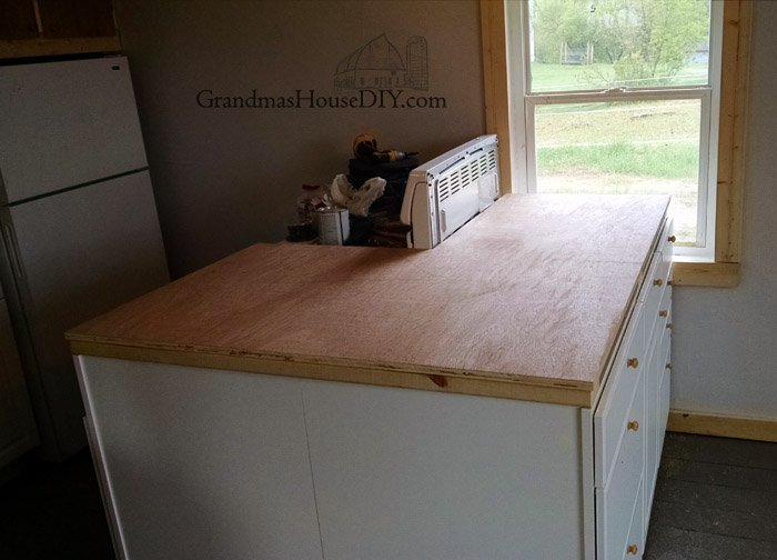 How to install a maple counter tops do it yourself with plywood, poly acyrlic, sanding and a skill saw, beautiful diy inexpensive wood kitchen countertops!