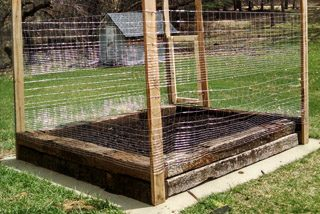 A new vegetable garden made of railroad ties and how I made the gate and put a fence around it. Balancing the choice of toxic railroad ties for a garden.
