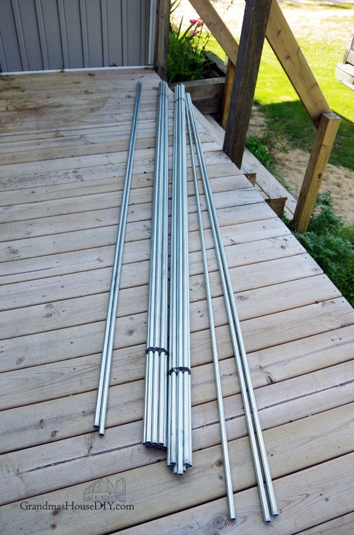 Diy inexpensive deck rails out of steel conduit easy to do for How to build an inexpensive deck
