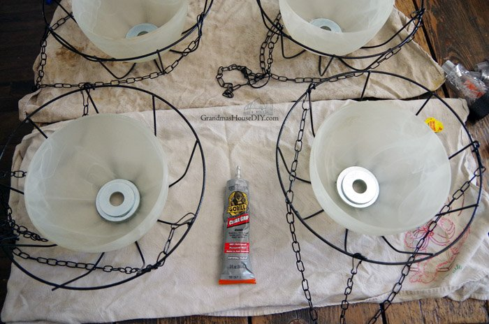 How to make DIY hanging solar light bird feeders by upcycling glass bowl light shades off of a chandelier. Easy bird feeders with additional $1 solar lights from walmart, lighting for your backyard and deck as well as a great spot for squirrels, chipmunks and birds to eat all year.