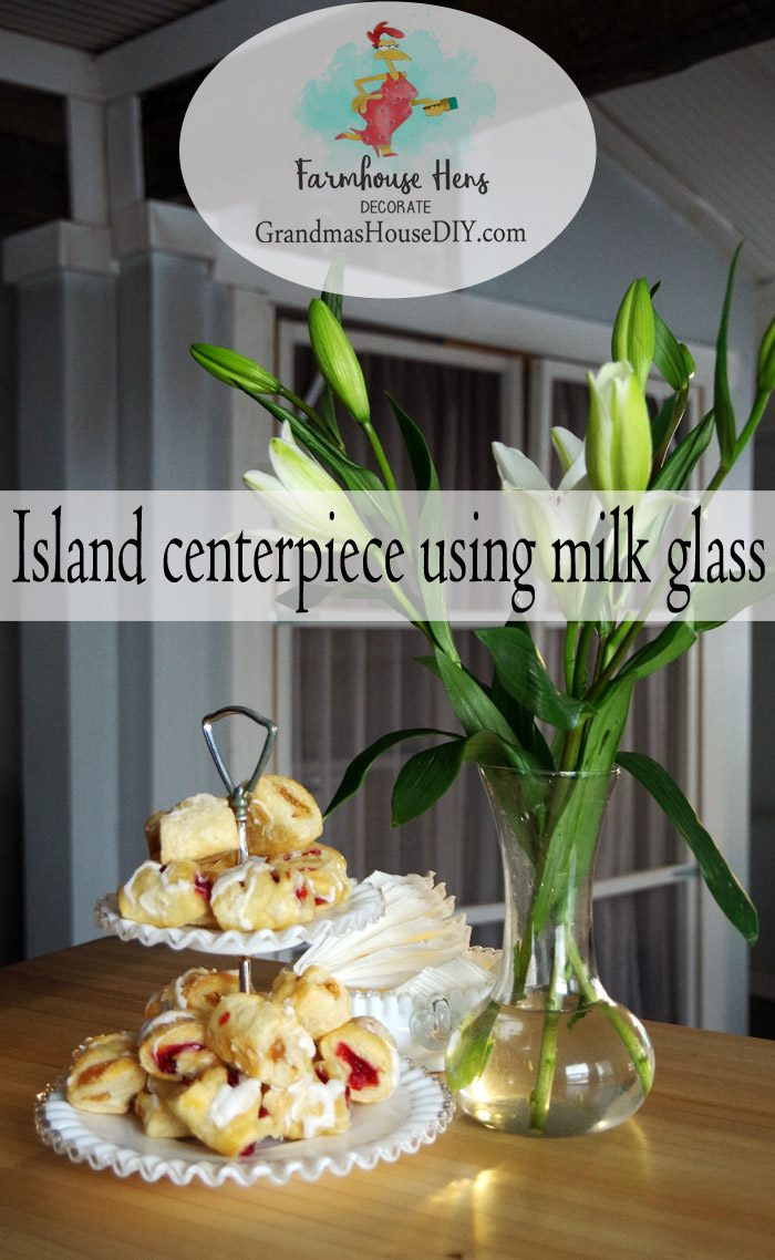 Island centerpiece using milk glass with the Farmhouse Hens Decorate! Milk glass for a country chic and farm house style using some old and some new pieces to create something fun and beautiful. DIY Do it yourself farm house and country decorating and design!