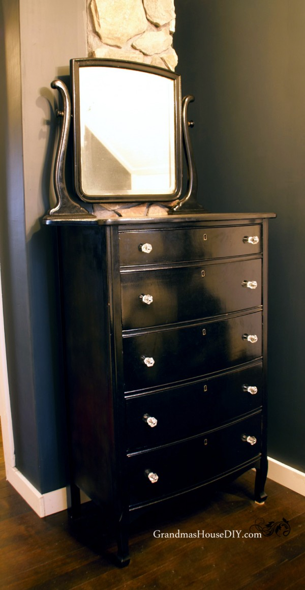 Paint an old dresser with a mirror black and add glass knobs for an old Hollywood look and feel in my master bedroom! @GrandmasHousDIY