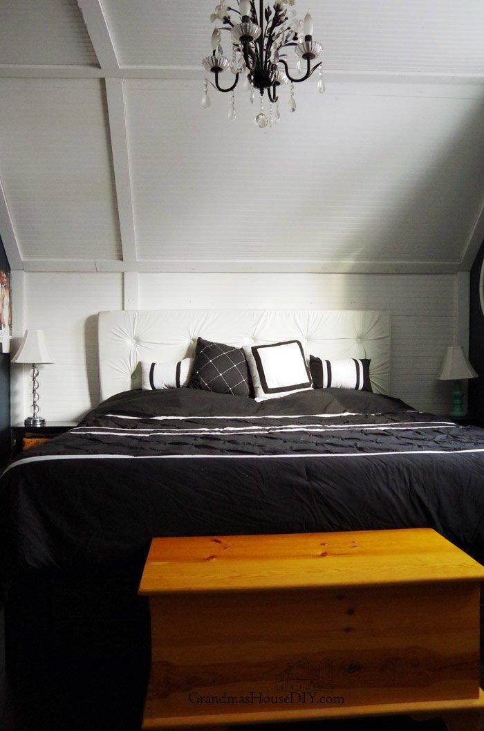 Master bedroom refresh country, hollywood regency makeover, white tufted headboard, glass lamp and hardware, black painted furniture, dark hardwood floors