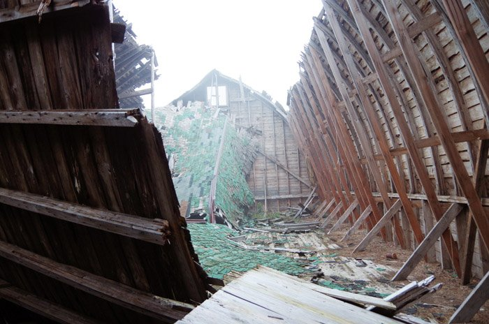 A photo gallery of an old barn in northern minnesota with a broken spine, fallen down roof, proving that beauty is in the eye of the beholder.
