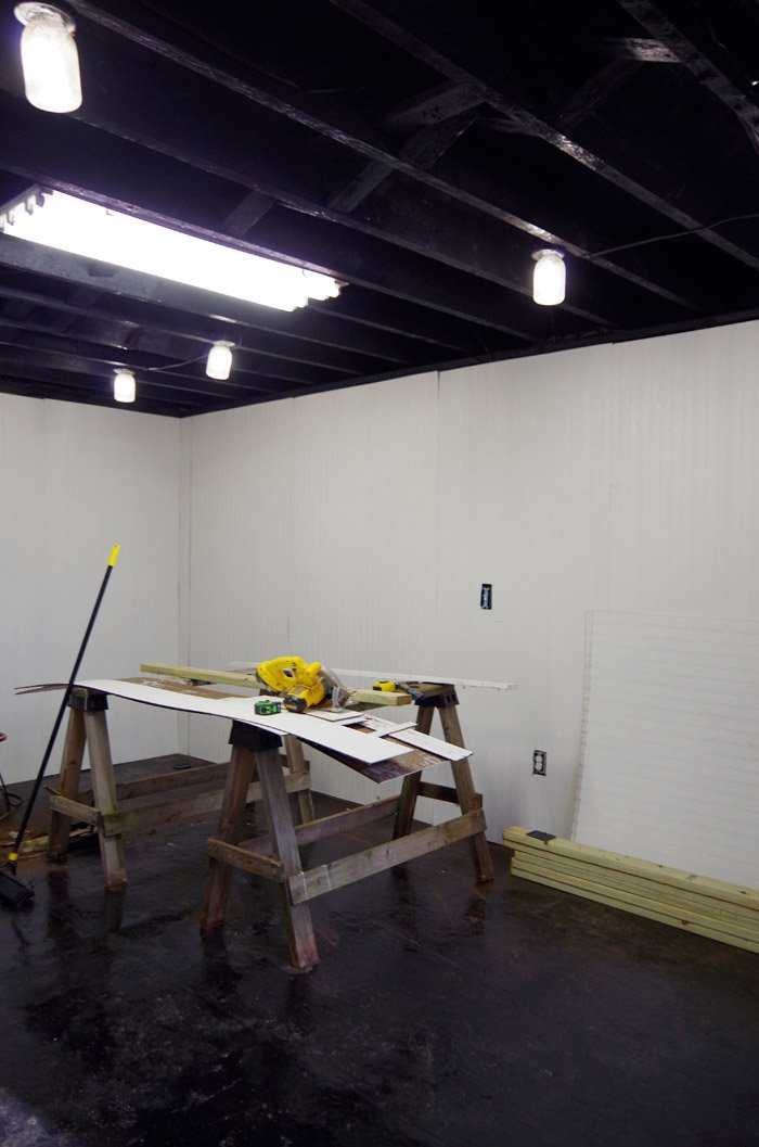 Putting up plyboard and trim on our basement walls. When we talked about the material we were going to use on our we walls we agreed no sheet rock
