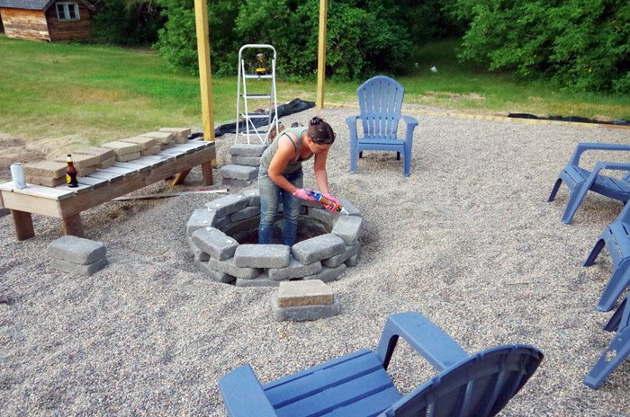 Stone fire pit and bench - How to Build a Cozy and safe Fire Pit. Our previous fire pit was totally surrounded by sand so it gave us...