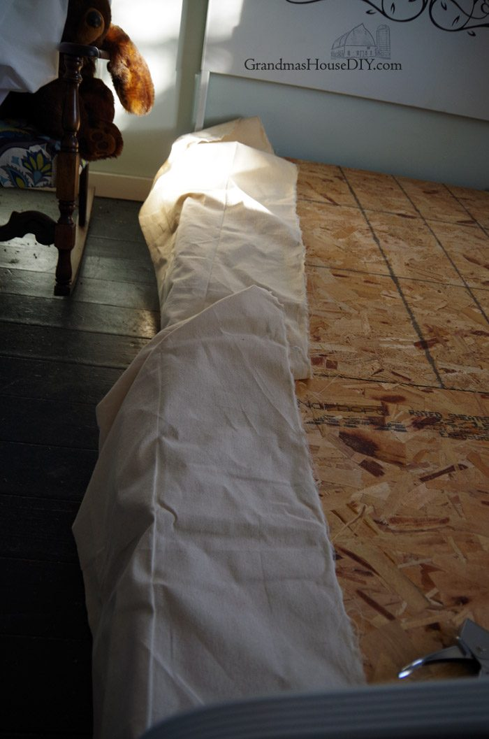 How to make a country style, farmhouse girl, no-sew bed skirt using inexpensive canvas drop cloth and staples. So simple this DIY is super easy, makes an inexpensive bed skirt that NEVER moves or falls off the bed and is customization to any size you need!