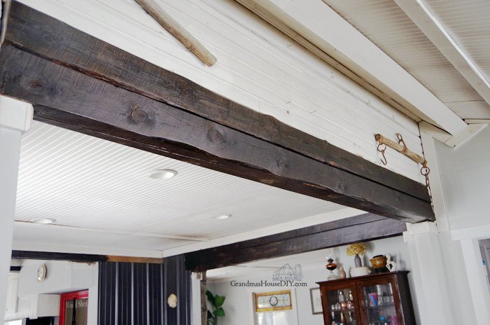 Sanding down and Refinishing the Beams Throughout my Home with a orboitol palm sander and determination, refinished with minwax dark walnut stain polycrylic