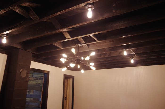 Basement lighting - moody. Creating a basement speak easy with edison bulbs and an edison bulb chandelier. Moody and warm and cozy