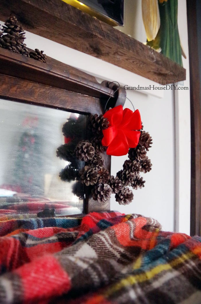 Holiday decor, decorating my mantel and entertainment center for Christmas! Mini clothes pins, burlap bows and mason jars just in time for the holidays.