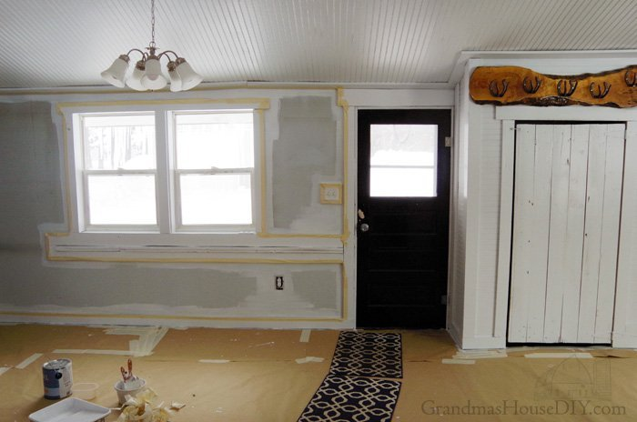 Painting the front entryway of my home - OMG the black smoke damage and stains. Not the last of my posts that will include a rant my horrible wood stove