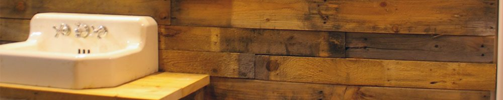 Covering the walls of my basement bathroom with pallet and barn wood instead of sheet rock during the renovation of my basement workshop Covering the walls of my basement bathroom with pallet and barn wood instead of sheet rock during the renovation of my basement workshop