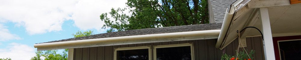 "PVC rain gutters DIY out of a 3"" PVC pipe cut in half with a table saw and then screwed to the eve using steel hex nut screws, how to, do it yourself"