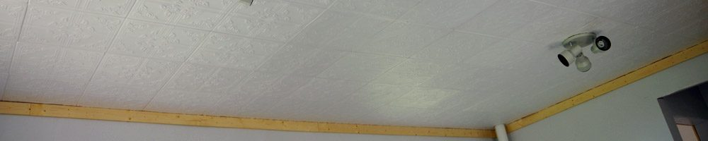 Easy to install Styrofoam do it yourself ceiling tiles over an ugly ceiling, how to do in just an afternoon using caulk and scissors!
