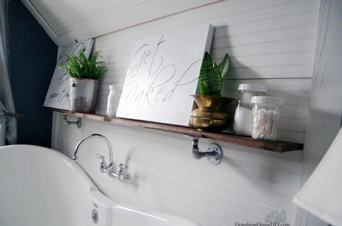 Adding a Shelf in my Master Bathroom using galvanized pipe hardware for storage, plants and creating a homey, comforting, green space that just says, relax and enjoy and bathe in peace and quiet. DIY, do it yourself, how to hang a shelf using pipe hardware store.
