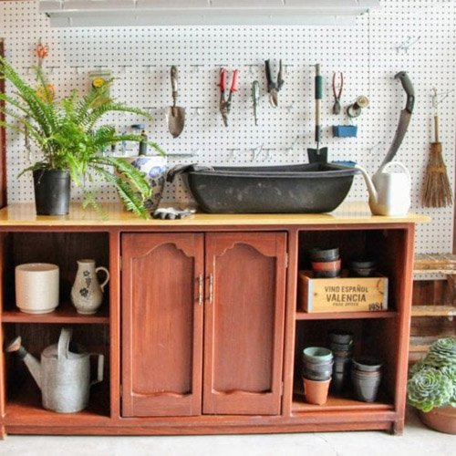 An Old Entertainment Center Becomes A Potting Bench