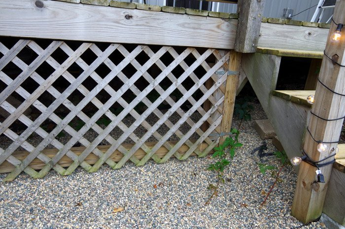 That helped a lot but I really needed to come up with a riser solution to cover up the ugly under the deck staircase using lattice and fabric