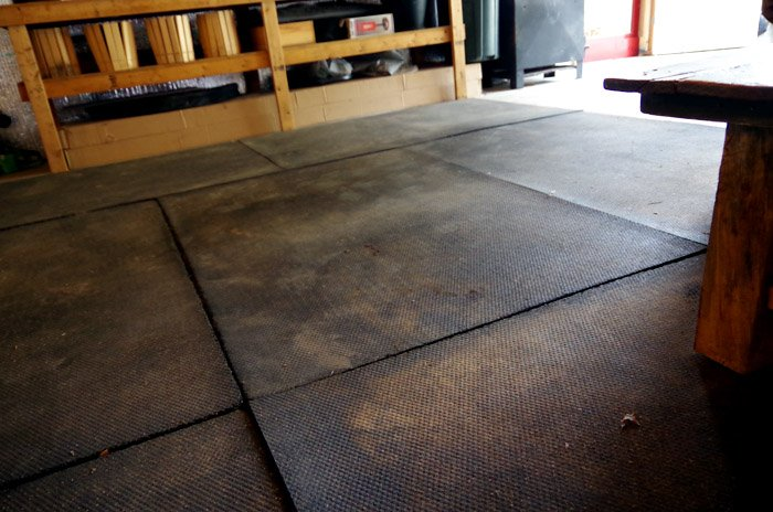 Using very heavy livestock mats to make a very over qualified area rug in the back of my garage. Horse stalls, underfoot mat for over concrete.