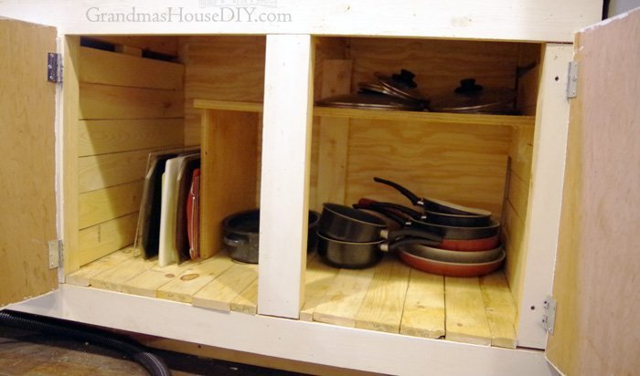 Adding purchased slide out storage shelves and solutions to my lower cabinets, major upgrades to organization in my kitchen remodel progress