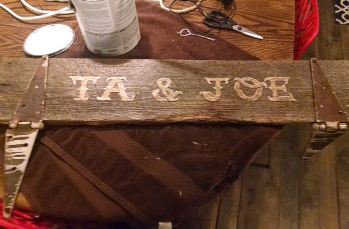 Using vinyl words and lettering to make a new sign for the front of my house. Storyhardt Farm est. 12/15/17 Welcome to Grandma's House. DIY Do it yourself, tips on how to apply vinyl lettering and paint to an old sign with rusty old hinges for a farmgirl and country girl look!