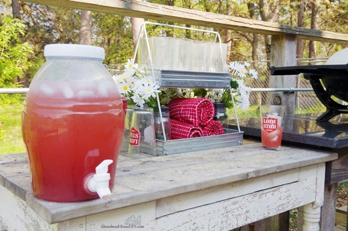 Drink Station Decoration summery outdoor decor with daisies checkered towels and table cloths, rustic, farmhouse living and life out on the deck party