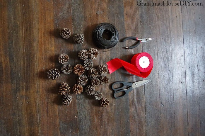 DIY How to Pine Cone Pinecone wreath. How to make a small wreath out of pine cones. Easy pine cone diy wreath with wire and a big red bow, do it yourself