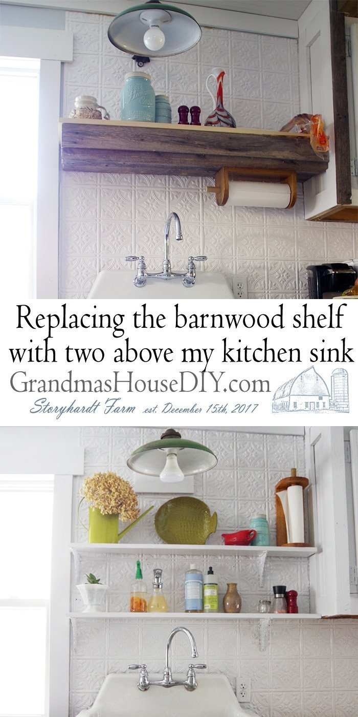 White open kitchen shelves with prety corbels painted white above my 100 year old cast enamel kitchen sink and DIY do it yourself sink base out of barn wood