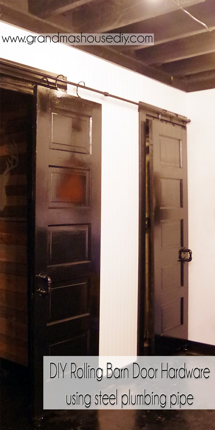 How to inexpensively create rolling barn door hardware with salvaged doors, black pipe. Moving back to completing our basement with doors