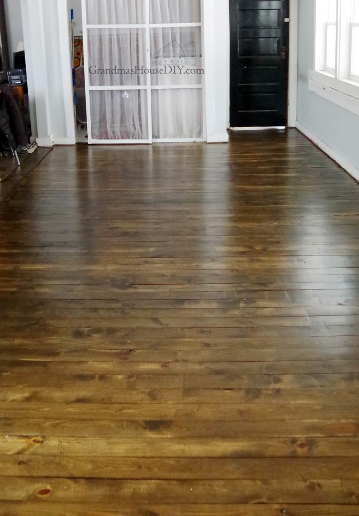 Inexpensive wood floor that looks like a million dollars - Four years later! Make your own DIY wood floors using 1x4 pine boards, sand down, stain and seal