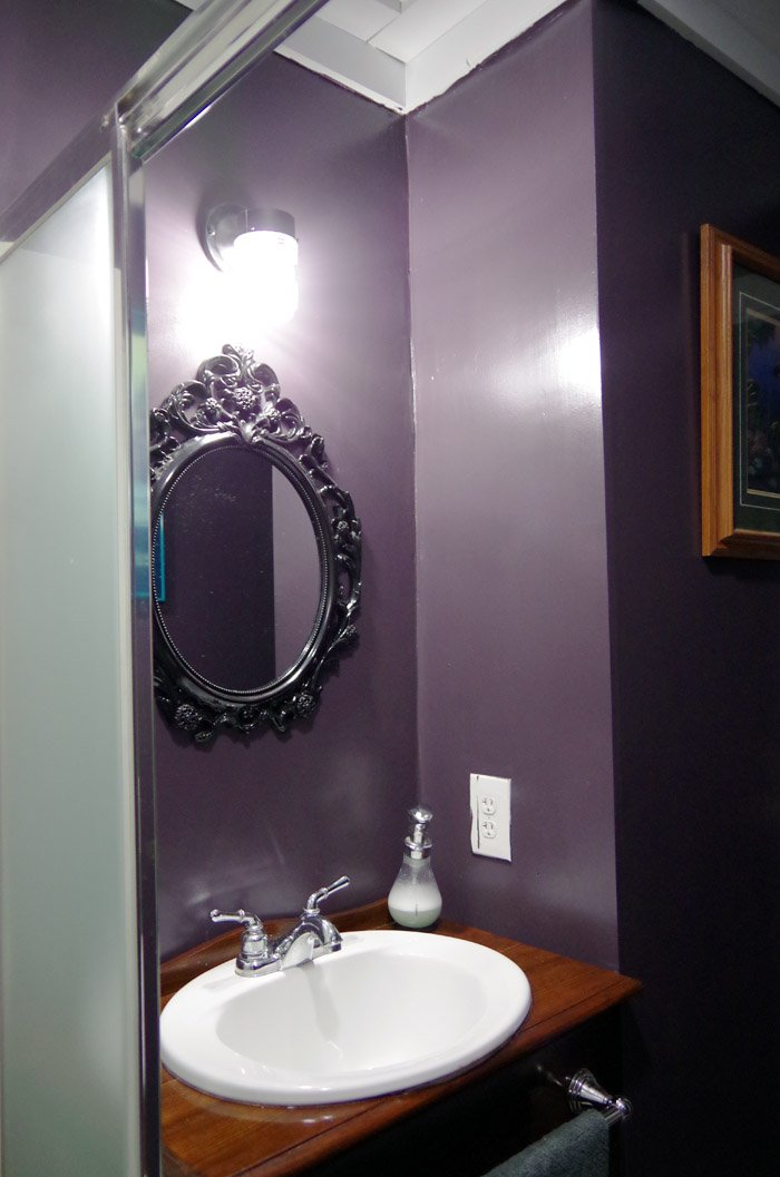 A before and after of my main floor bathroom in my Grandma's farmhouse that I renovated and tiny bathroom ideas and reveal remodeling, valspar purple paint