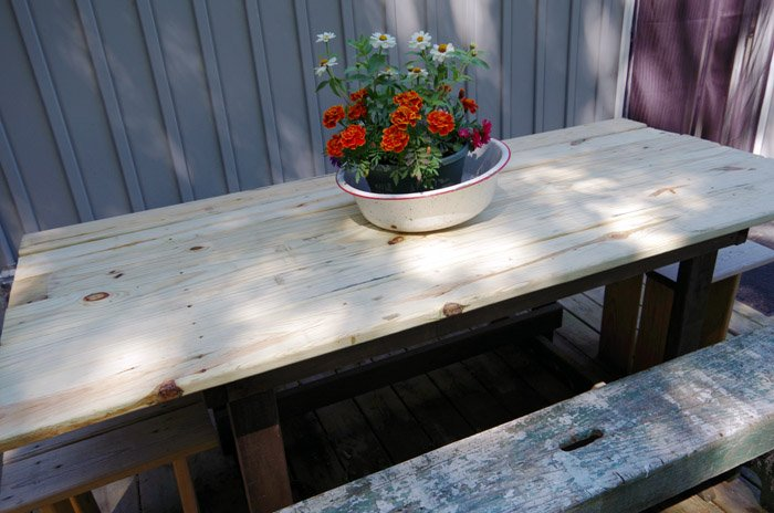 Replacing my barn door table top with a lasting outdoor table top for our deck after the barn door was damaged by ice last winter - green treated building