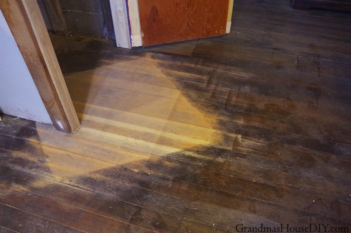 How to spot stain a 100 year old hardwood floor to make the unfinished floor and the finished floor blend in to each other make it disappear