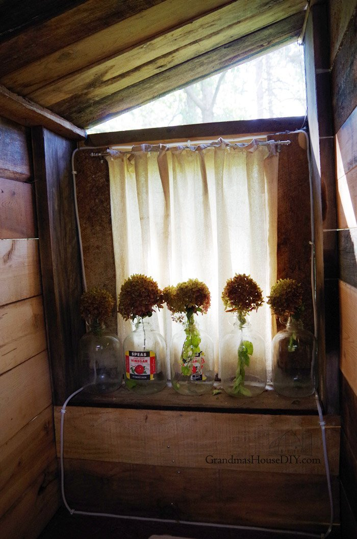 My New Outhouse Reveal! All dressed up Before and After! Hydrangeas, antique glass cinegar jars, antique old mirror and coat hooks shabby shic country style