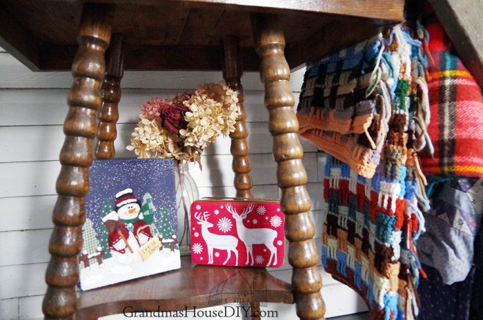 Farmhouse Hens Decorate DIY winter vignette with inherited objects from grandma, farm style, country girl decorating, quilt, oil lamp, red bows, hydrangea, dried hydrangeas, plaid, blanket ladder rack, do it yourself with what you have on hand!